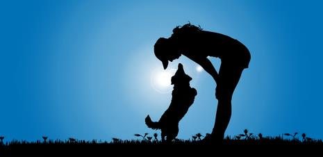 Silhouette of woman and a female dog