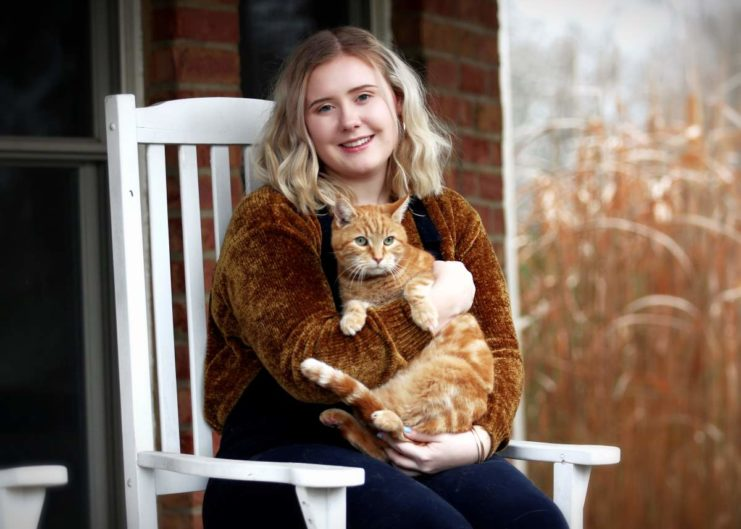a woman with an adopted ginger adult cat