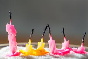 Six blow out candles on a birthday cake
